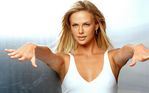Charlize_Theron_by_Lord_Golberg_(8).jpg